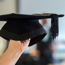 Holding a mortarboard