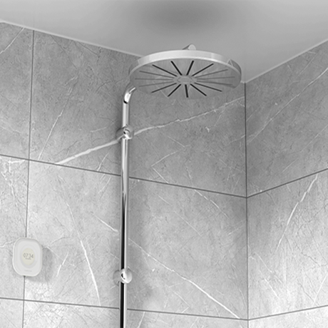 Aguardio Shower Sensor next to a silver showerhead.