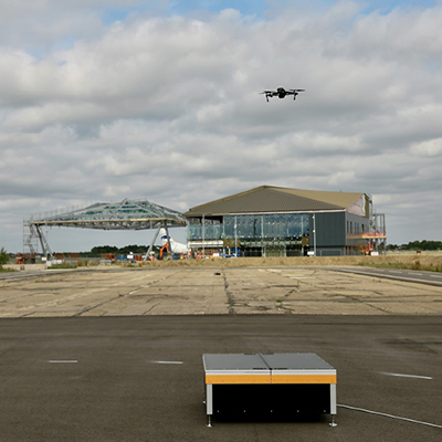 An unmanned aerial vehicles (UAVs) inspecting the runway at Cranfield Airport