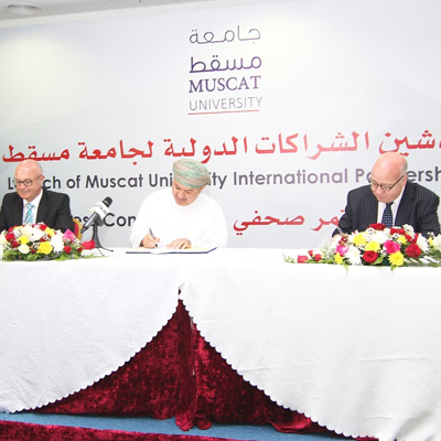 Professor Simon Pollard signs the international partnership agreement in Oman