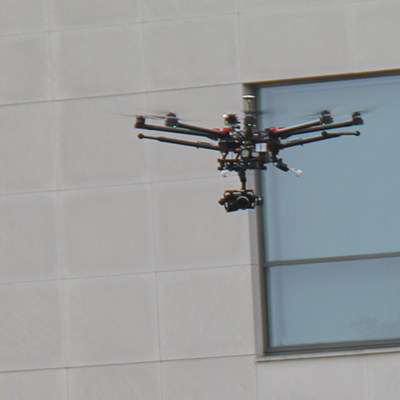 Drone flying near building