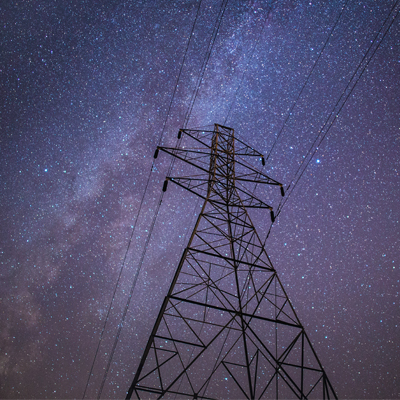 Electricity powerline against starry sky