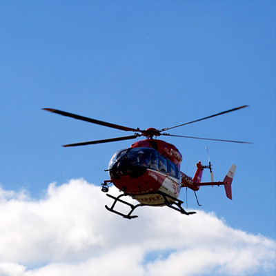 Helicopter in flight on blue sky