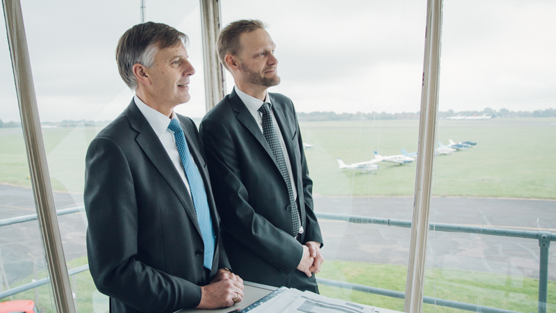 Johan Klintberg and Sir Peter Gresgon view the airfield