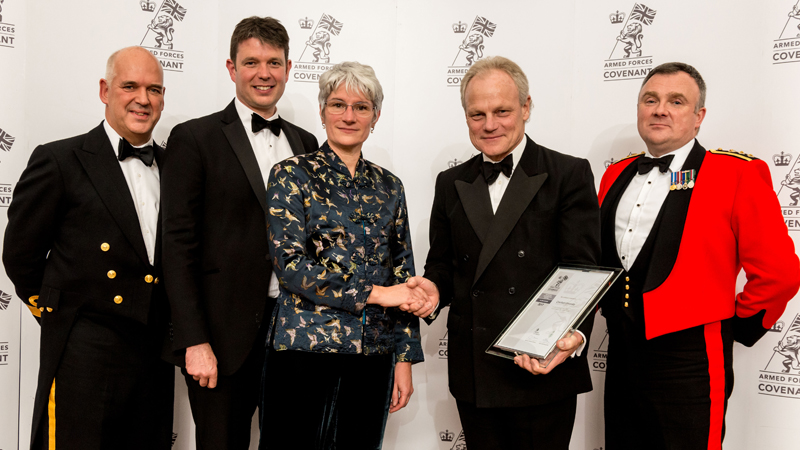 Cranfield University representatives collecting Armed Forces Employer Recognition Scheme Silver award