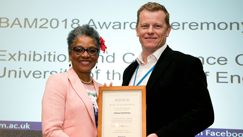 Peaches Golding and David Denyer holding a certificate