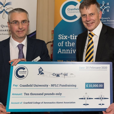Prof Andy Foster and Sir Peter with £10,000 cheque