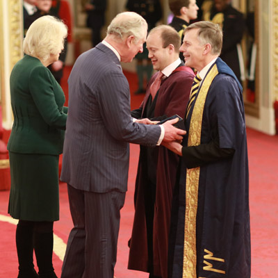 Peter Gregson and Graham Braithwaite collect award from Duke and Duchess of Cornwall