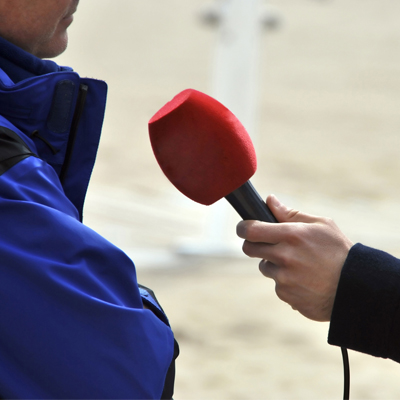 Interview with microphone - Cranfield Media Relations