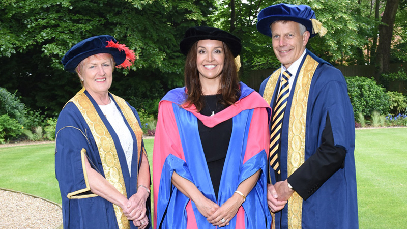 Sarah Willingham receiving an honorary degree from Cranfield University