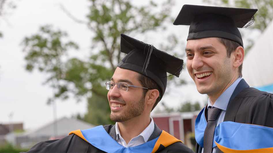 Photo of two male graduates