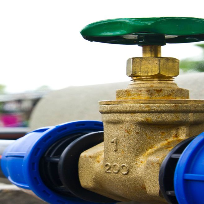 Close up of water valve - green tap