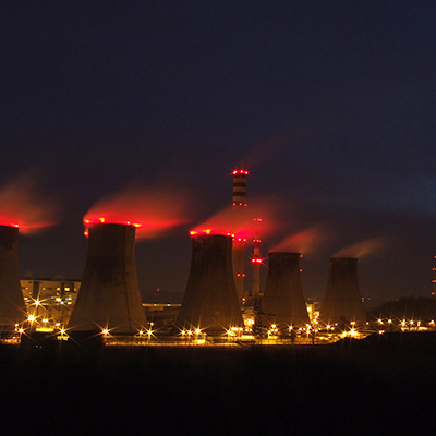 Power plant at night - energy supply low carbon futures