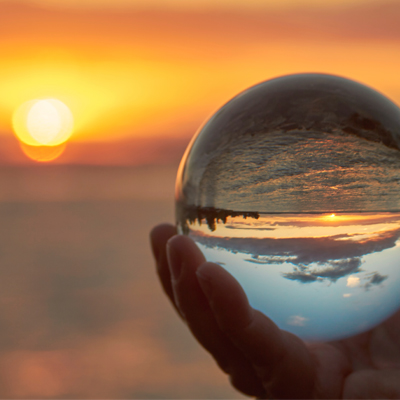 Sunset reflected in a glass ball